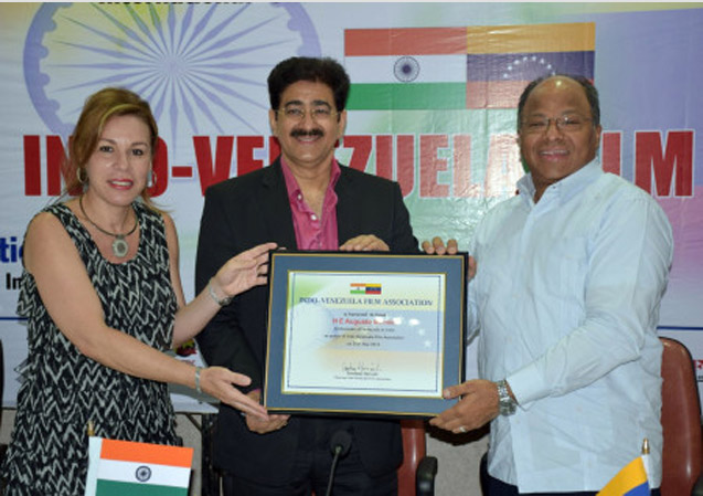 """Noida: """"The enthusiasm, support and encouragement given by H.E. Augusto Montiel Ambassador of Venezuela to India has motivated International Chamber of Media And Entertainment Industry to launch Indo Venezuela Film Association,"""" said Sandeep Marwah President of ICMEI. """"We are now powerful as H.E. Augusto Montiel has accepted to be the Patron of the organization."""" added Sandeep Marwah while handing over the certificate of patron ship to the Ambassador at Noida Film City. """"It is my honor and pleasure to be part of this newly constituted association. I am sure we will be able to reach to a new platform together,"""" said H.E. Augusto Montiel. Student, faculty and members of the administration of Asian Academy of Film And Television, Asian School of Media Studies and professionals attended the event from different strata of life. Mrs Mili Augusto also graced the occasion."""